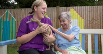 Birchlands resident Jackie Wilson with carer Sarah Weller and pet duck