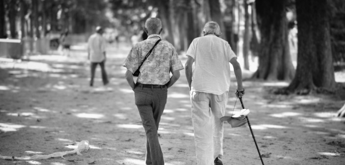 elderly-men-besties-walking-in-parisian-park