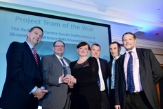 Knightsbridge Furniture MD Alan Towns (left) presents IBI Nightingale with the Project Team of the Year trophy at DiMH 2014