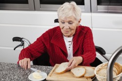 Lady on wheelchair making breakfast