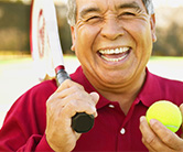 Man with a tennis ball and a racquet