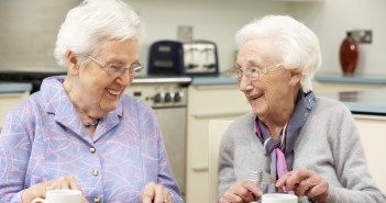 Senior women enjoying meal together at home
