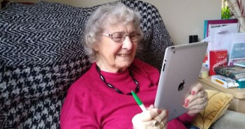 june chats with children on tablet